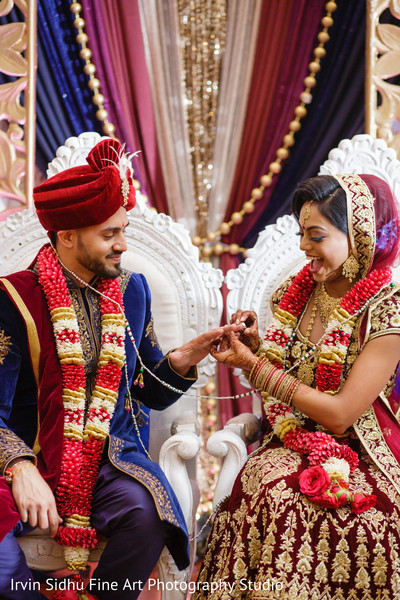 Indian bride giving the wedding ring to her raja in Brampton, ON Indian Wedding by Irvin Sidhu Fine Art Photography Studio
