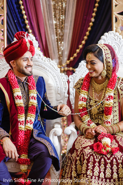 Happy Indian couple in their wedding ceremony in Brampton, ON Indian Wedding by Irvin Sidhu Fine Art Photography Studio