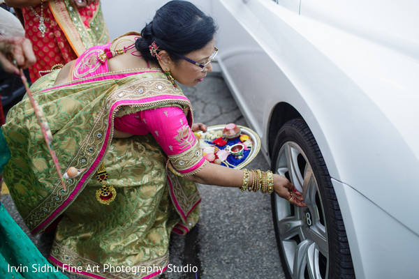 Blessing the transportation Indian couple will be using in Brampton, ON Indian Wedding by Irvin Sidhu Fine Art Photography Studio