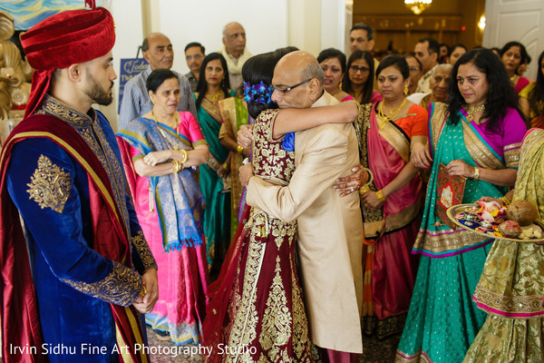 Family saying their goodbyes to the Indian bride in Brampton, ON Indian Wedding by Irvin Sidhu Fine Art Photography Studio