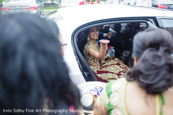 Indian bride kissing goodbye to her family in Brampton, ON Indian Wedding by Irvin Sidhu Fine Art Photography Studio