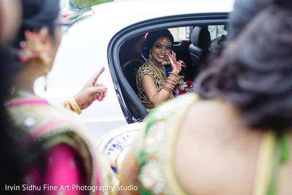 Indian bride saying goodbye after her wedding ceremony in Brampton, ON Indian Wedding by Irvin Sidhu Fine Art Photography Studio