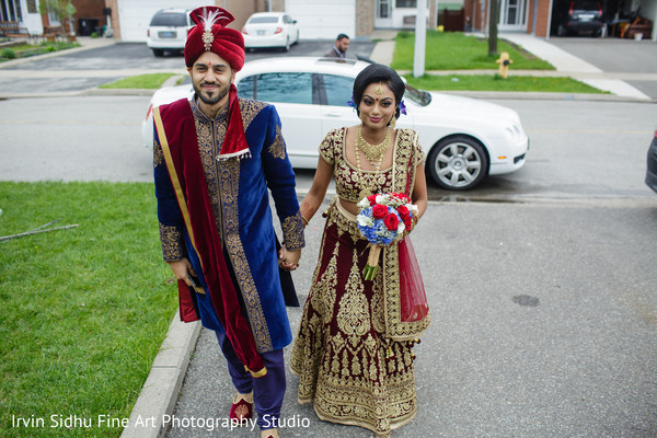 Lovely Indian couple entering their home in Brampton, ON Indian Wedding by Irvin Sidhu Fine Art Photography Studio