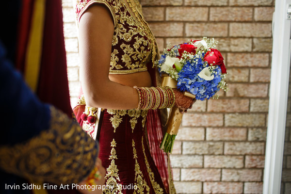 Indian bride carrying a beautiful flower bouquet in Brampton, ON Indian Wedding by Irvin Sidhu Fine Art Photography Studio