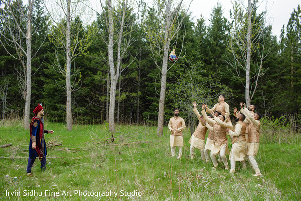 Indian groomsmen catching the flower bouquet in Brampton, ON Indian Wedding by Irvin Sidhu Fine Art Photography Studio