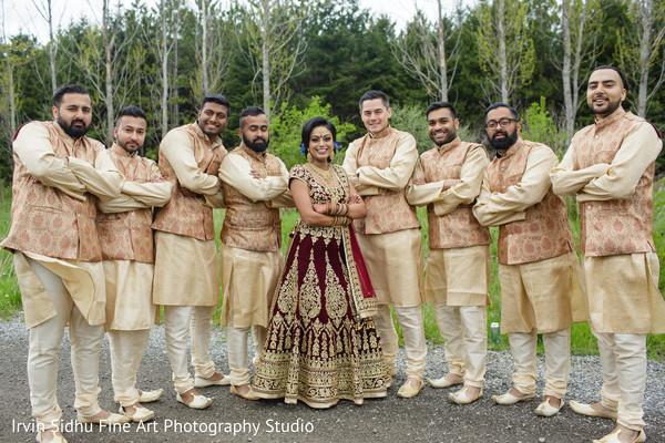 Maharani posing with groomsmen in Brampton, ON Indian Wedding by Irvin Sidhu Fine Art Photography Studio