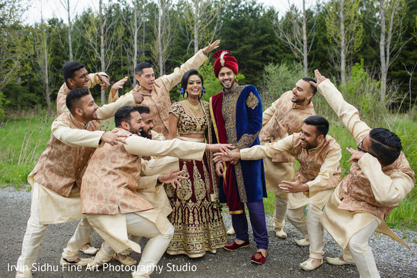 Maharani and Raja posing with groomsmen in Brampton, ON Indian Wedding by Irvin Sidhu Fine Art Photography Studio