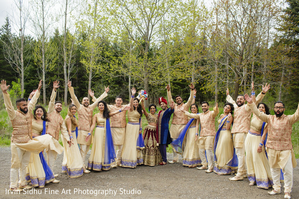 Indian couple celebrating with bridesmaids and groomsmen in Brampton, ON Indian Wedding by Irvin Sidhu Fine Art Photography Studio