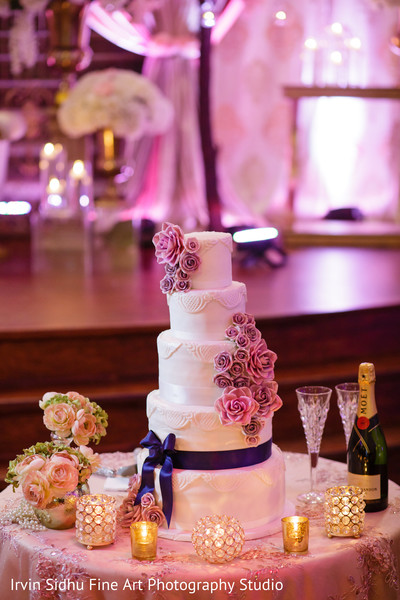 Perfect cake setting in indian wedding reception in Brampton, ON Indian Wedding by Irvin Sidhu Fine Art Photography Studio