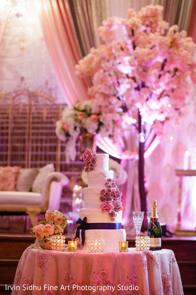 Beautiful cake table in this indian wedding reception in Brampton, ON Indian Wedding by Irvin Sidhu Fine Art Photography Studio