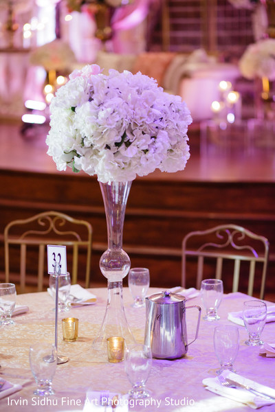 Lovely indian wedding reception centerpieces in Brampton, ON Indian Wedding by Irvin Sidhu Fine Art Photography Studio