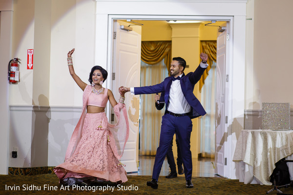 Indian couple making their entrance to their wedding reception in Brampton, ON Indian Wedding by Irvin Sidhu Fine Art Photography Studio