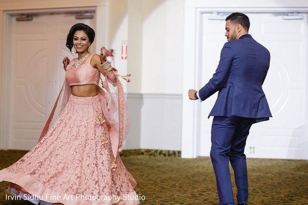 Beautiful bride and groom dancing in Brampton, ON Indian Wedding by Irvin Sidhu Fine Art Photography Studio