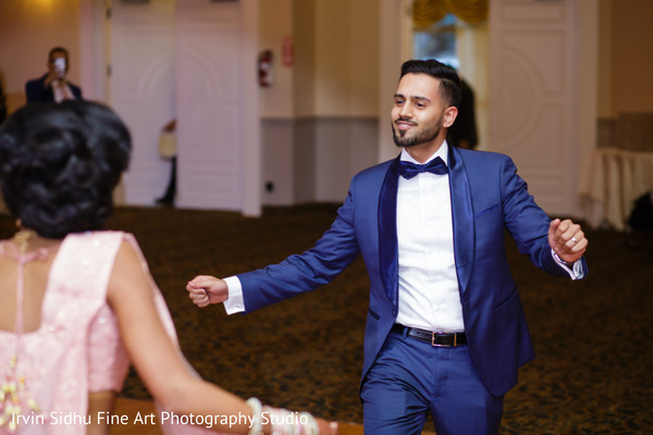 Happy Groom dancing at his Wedding Reception in Brampton, ON Indian Wedding by Irvin Sidhu Fine Art Photography Studio