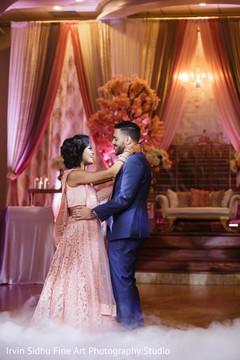 Beautiful Indian couple dancing at their wedding