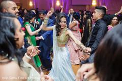 Beautiful Indian bride dancing at her wedding