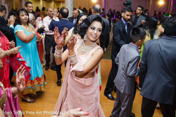 Maharani leading the way in the dance floor in Brampton, ON Indian Wedding by Irvin Sidhu Fine Art Photography Studio