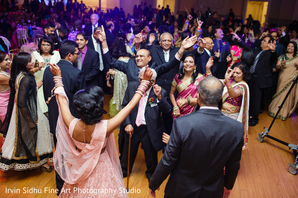 Maharani getting the party started with the guests in Brampton, ON Indian Wedding by Irvin Sidhu Fine Art Photography Studio