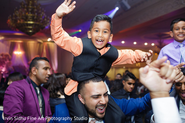 Sweet little kid dancing at indian wedding reception in Brampton, ON Indian Wedding by Irvin Sidhu Fine Art Photography Studio