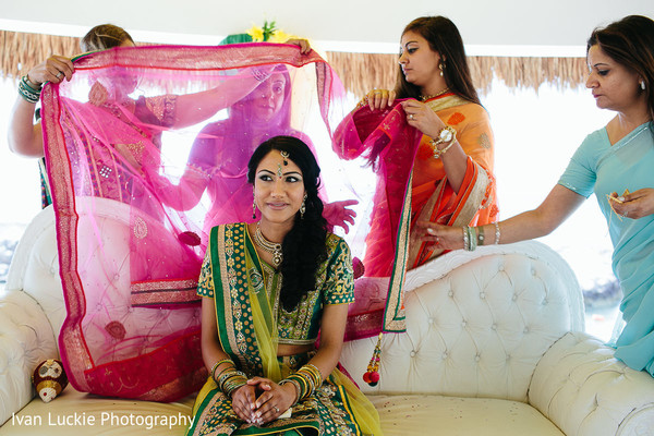 Indian bride during her engagement ceremony. in Playa del Carmen Playa del Carmen Destination Indian Wedding by Ivan Luckie Photography