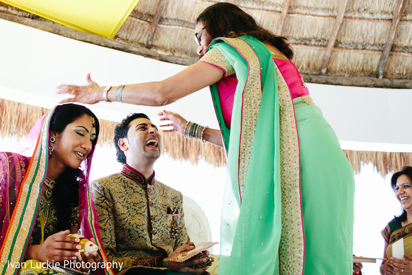 Indian engaged couple getting blessings from family and friends. in Playa del Carmen Playa del Carmen Destination Indian Wedding by Ivan Luckie Photography