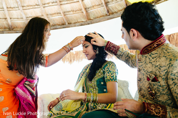 See this cute couple sharing a beautiful moment in their engagement ceremony. in Playa del Carmen Playa del Carmen Destination Indian Wedding by Ivan Luckie Photography