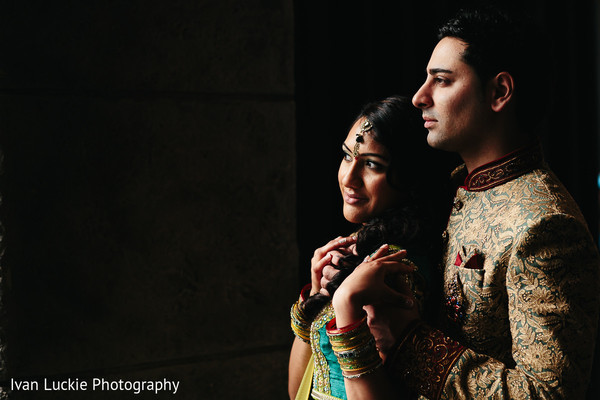 Portrait of lovely indian engaged couple with a black backround. in Playa del Carmen Playa del Carmen Destination Indian Wedding by Ivan Luckie Photography