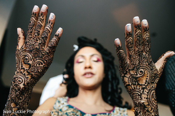 Indian bride  with bridal henna her hands and arms. in Playa del Carmen Playa del Carmen Destination Indian Wedding by Ivan Luckie Photography