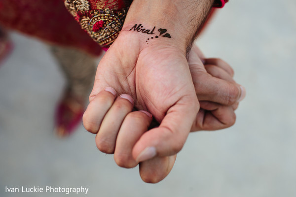 Groom showing hist romantic henna tattoo. in Playa del Carmen Playa del Carmen Destination Indian Wedding by Ivan Luckie Photography