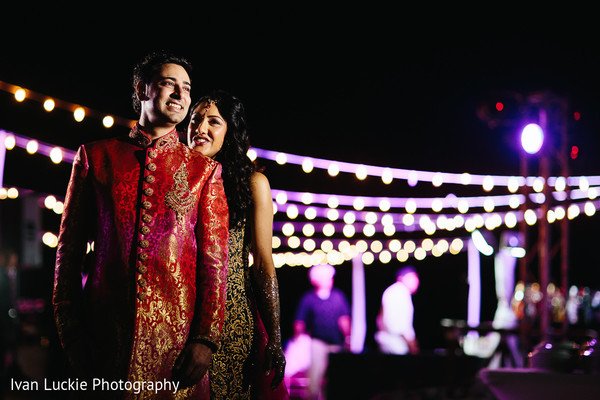 Indian bride and groom during their Outdoor mehndi party. in Playa del Carmen Playa del Carmen Destination Indian Wedding by Ivan Luckie Photography