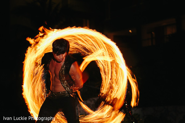Fire dancers performing during the mehndi party in Playa del Carmen Playa del Carmen Destination Indian Wedding by Ivan Luckie Photography