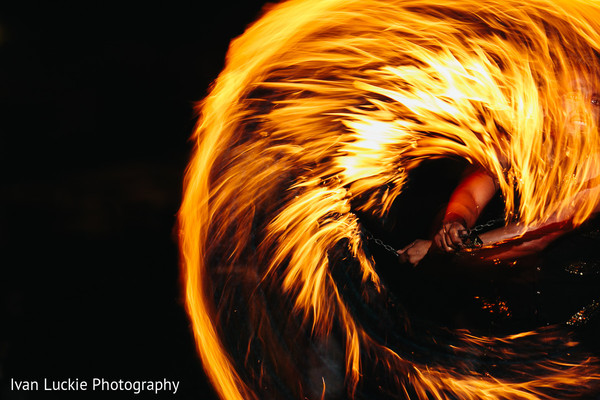 Amazing capture of fire dancers in Playa del Carmen Playa del Carmen Destination Indian Wedding by Ivan Luckie Photography