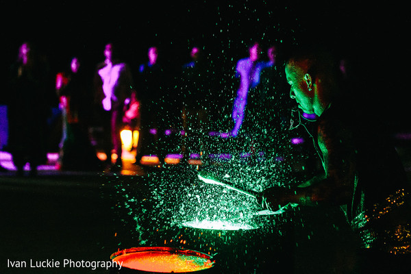 Wet drum performance show. in Playa del Carmen Playa del Carmen Destination Indian Wedding by Ivan Luckie Photography