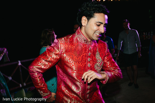 Groom dancing to the rhythm of the music in Playa del Carmen Playa del Carmen Destination Indian Wedding by Ivan Luckie Photography