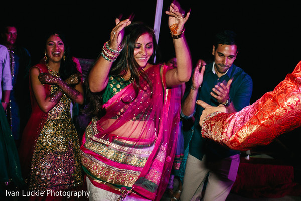 Guests enjoying the music of the mehndi night in Playa del Carmen Playa del Carmen Destination Indian Wedding by Ivan Luckie Photography