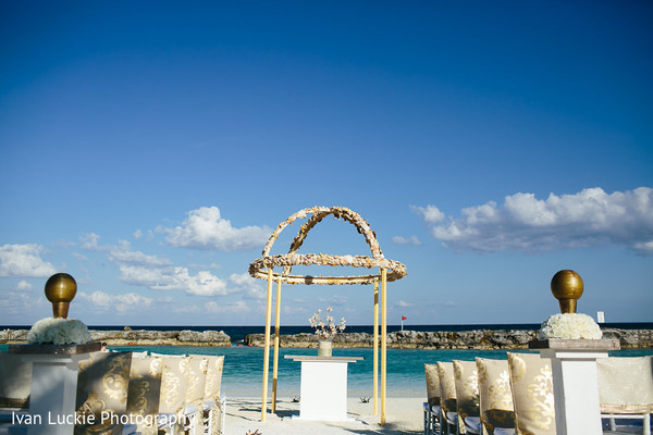 Beautiful beach wedding altar. in Playa del Carmen Playa del Carmen Destination Indian Wedding by Ivan Luckie Photography