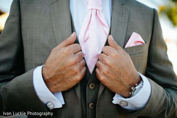 Groom showing his elegant pink tie. in Playa del Carmen Playa del Carmen Destination Indian Wedding by Ivan Luckie Photography
