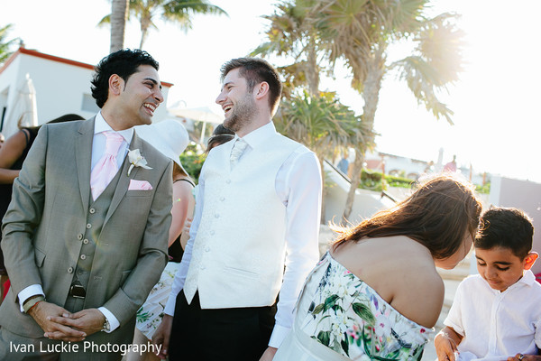 Indian groom laughing moments before the ceremony. in Playa del Carmen Playa del Carmen Destination Indian Wedding by Ivan Luckie Photography