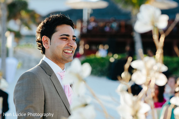 Look at this handsome indian groom waiting for his bride. in Playa del Carmen Playa del Carmen Destination Indian Wedding by Ivan Luckie Photography