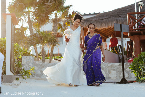 Stunning indian bride wearing her white dress and walking down the aisle. in Playa del Carmen Playa del Carmen Destination Indian Wedding by Ivan Luckie Photography