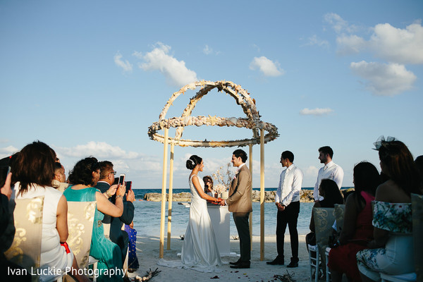 Indian bride and groom exchanging rings at Riviera Maya. in Playa del Carmen Playa del Carmen Destination Indian Wedding by Ivan Luckie Photography
