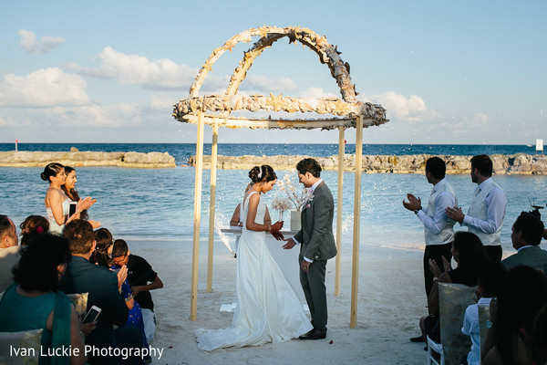 Romantic capture of the outdoor ring exchange ceremony. in Playa del Carmen Playa del Carmen Destination Indian Wedding by Ivan Luckie Photography