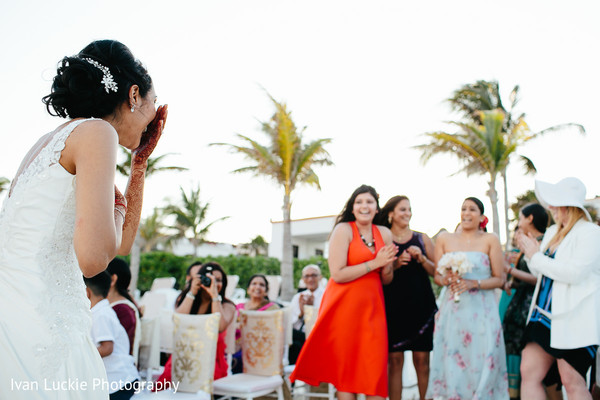 Indian bride suprised after throwing the bouquet. in Playa del Carmen Playa del Carmen Destination Indian Wedding by Ivan Luckie Photography