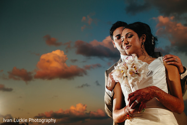 Portrait of indian bride and groom in a lovely sunset. in Playa del Carmen Playa del Carmen Destination Indian Wedding by Ivan Luckie Photography