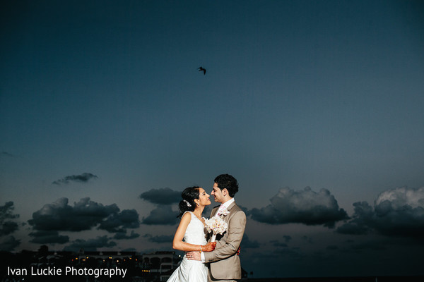 Portrait of indian bride and groom in a beautiful beach sunset. in Playa del Carmen Playa del Carmen Destination Indian Wedding by Ivan Luckie Photography