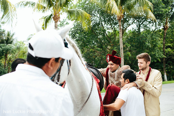Indian groom getting ready for Baraat in Playa del Carmen Playa del Carmen Destination Indian Wedding by Ivan Luckie Photography