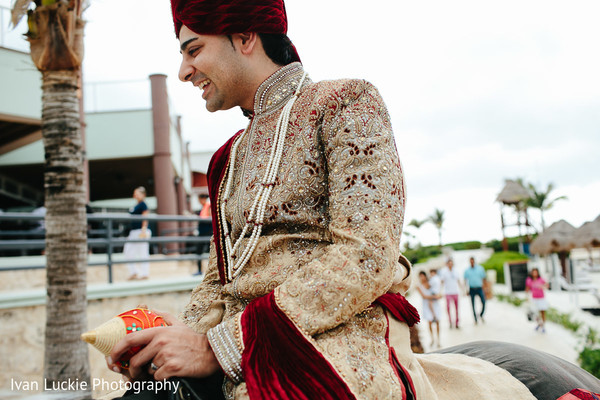 See indian groom during baraat. in Playa del Carmen Playa del Carmen Destination Indian Wedding by Ivan Luckie Photography