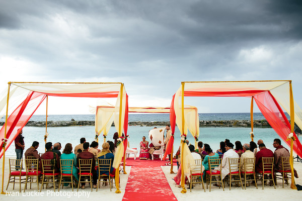 Gold and red indian ceremony wedding decoration. in Playa del Carmen Playa del Carmen Destination Indian Wedding by Ivan Luckie Photography