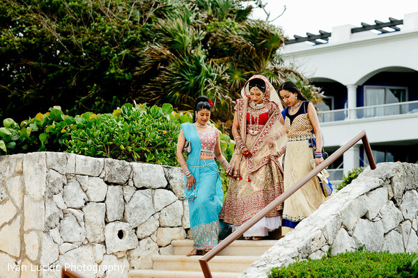 Indian bride walking down the aisle. in Playa del Carmen Playa del Carmen Destination Indian Wedding by Ivan Luckie Photography