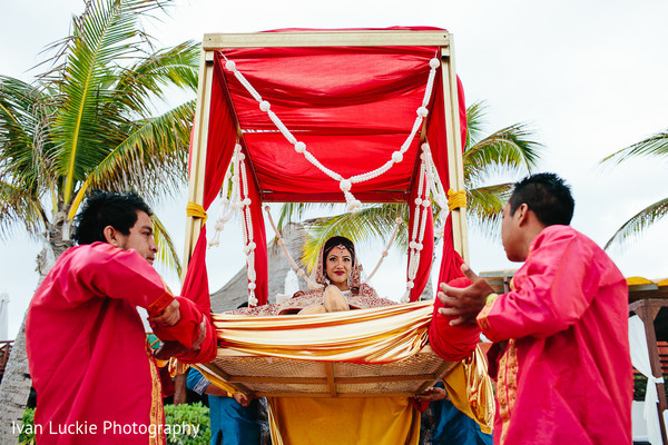 Entrance of indian bride to wedding ceremony. in Playa del Carmen Playa del Carmen Destination Indian Wedding by Ivan Luckie Photography